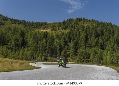 Motorcycle on dangerous and winding road in the high mountains