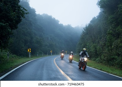 Motorcycle on foggy road in mystery land