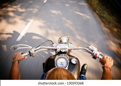 Motorcycle On A Open Road From A Different Point Of View.