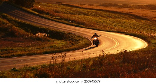 Motorcycle on the road at September evening.