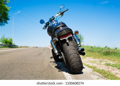 motorcycle parking on the road right side and sunset, sky background, nobody