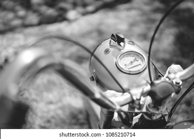 motorcycle parts headlight with vintage retro motorbike. old timer age concept, 1960s style, outdoor dirt road, black and white