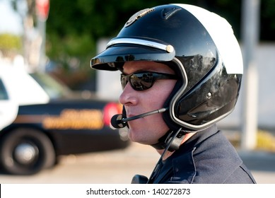 A motorcycle police officer watches traffic during his shift.