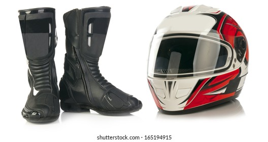 Motorcycle red and white helmet and black leather boots isolated on white background