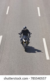 Motorcycle rider on the road. Travel and fun background. Vertical