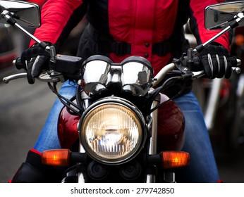 Motorcycle rider rushing at city street
