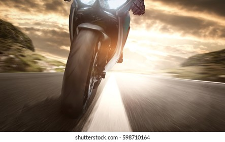 Motorcycle rides on a country road