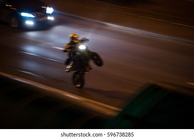 The motorcycle rides on the rear wheel. Motorcycle at speed.