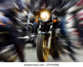 motorcycle rushing at city street, blurred motion