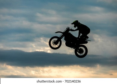 motorcycle silhouette are jumping, Freestyle Motocross