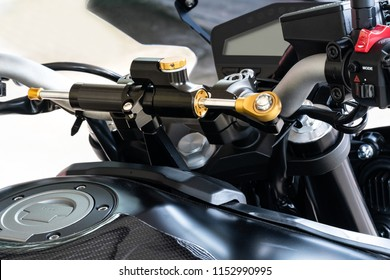 Motorcycle steering damper. A damper helps keep the bike tracking straight over difficult terrain such as ruts, rocks, and sand, and also smooths out jolts through the handlebars at the end of jumps.