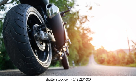 motorcycle in a sunny  motorbike on the road riding.copyspace for your individual text.