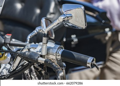 Motorcycle tourist details: mirror lamps and handle