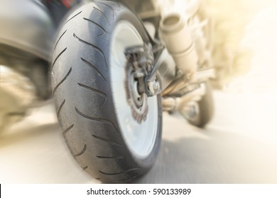 Motorcycle Tyre Big bike - Closeup Rear wheel of Bigbike motorcycle at the city street Technology Superbike and Transportation Background concept