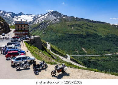 Motorcycles and cars parked at Hotel Belvedere on the road to Furka Pass, near Rhone Glacier. Valais, Switzerland, July 2018