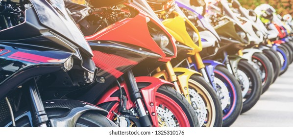 Motorcycles group parking on city street during adventure journey. Motorcyclists community travel concept.