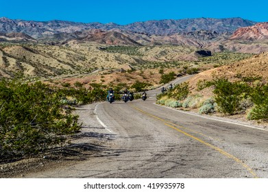 Motorcycles riding through the desert