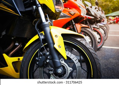 motorcycles standing in the row on asphalt closeup