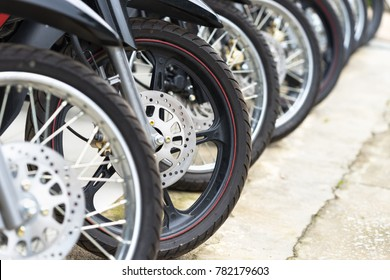 Motorcycles standing in the row at a store, closeup
