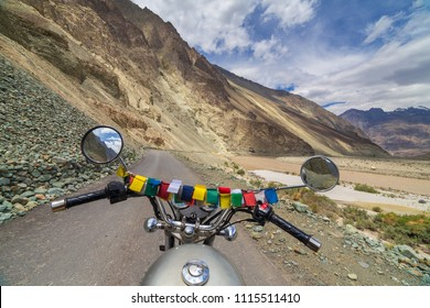 Motorcycling the Leh Manali Highway, a high altitude road that traverses the great Himalayan range, Ladakh, India. View from the rider side