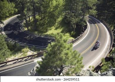 Motorcyclist driving on Iron Mountain Road, Black Hills, near Mount Rushmore National Memorial, South Dakota