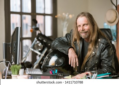 Motorcyclist with long hair at his desk