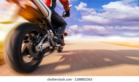 motorcyclist on the highway while overtaking with highspeed. he enjoys an adrenaline rush.