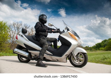 Motorcyclist on the motorcycle in helmet on the road