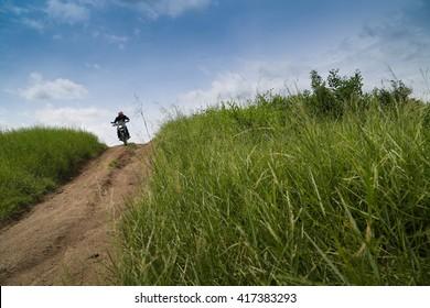 Motorcyclist on mountainous, extreme sport, active lifestyle, adventure touring concept