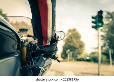 Motorcyclist on the road - Racing motorbike stops at traffic lights