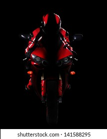 Motorcyclist in red equipment and helmet on black background low key silhouette