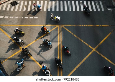 Motorcyclists at the crossroads in Bangkok view from above. traffic area. Rush hour for motorbikes, taxis and transportation.