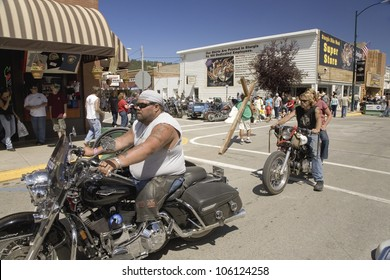 Motorcyclists driving down Main Street Sturgis at the 67th Annual Sturgis Motorcycle Rally, Sturgis, South Dakota, August 6-12, 2007