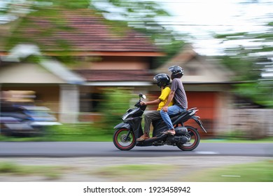 motorcyclists at high speed and photographed using motions blur (panning) technique in Jombang, East Java INDONESIA, 24th February 2021