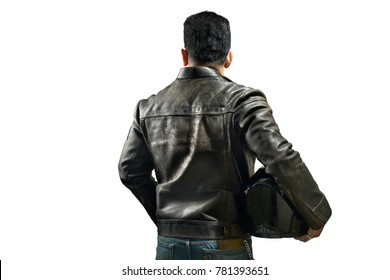A motorcyclist's man wears a leather jacket and holds motorcycle helmet.