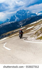 Motorcyclists on mountain bend road pass, Tre cime di Lavaredo , Dolomites, Italy.
