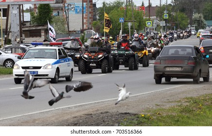 Motorcyclists on the street Shosseynaya. Russia, May 2017: A column of motorcyclists rides around the city of Zavodoukovsk. Siberia.
