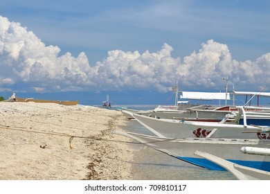 Motor-driven boats dock in the shores of Balicasag Island, Philippines. Famous for its great diving spot, the island also have white sand beaches around it.