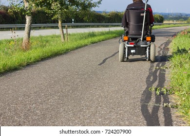 motor-driven wheel chair on a street in september fall season and sunny weather condition in south germany countryside near city of stuttgart