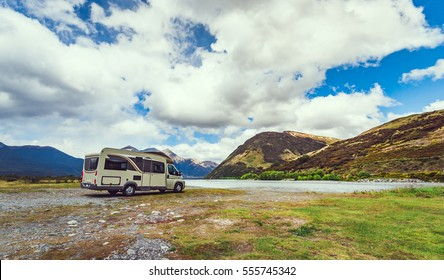 Motorhome parked by river in the Southern Alps of New Zealand.