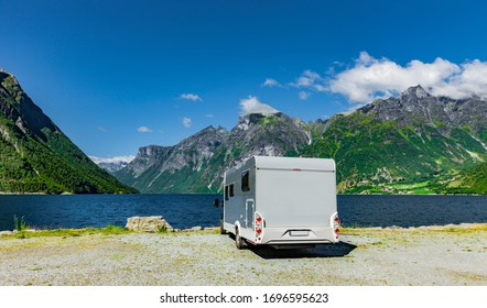 Motorhome stands directly on a fjord in Norway