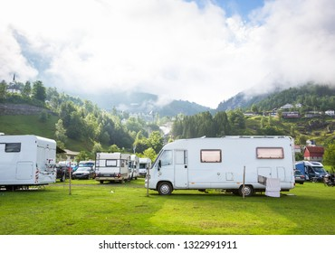 Motorhomes at campsite by the Geirangerfjord in Norway. Concept pictures.