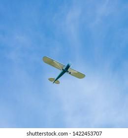 Motorsport airplane on the blue sky. Location: Germany, North Rhine-Westphalia, Borken,