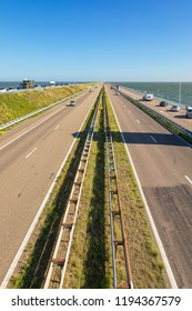 Motorway A7 on Afsluitdijk, a dam separating the North Sea from the Ijsselmeer lake. View from bridge at Breezanddijk, an artificial island.