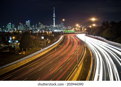 Motorway Car Trails with Auckland City Skyline