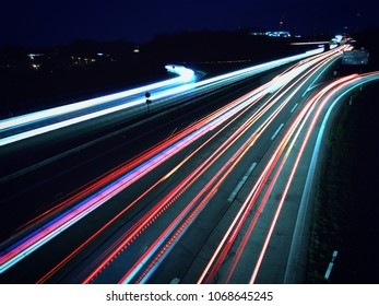 Motorway at night with motion blur of vehicles