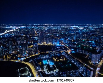 Motorway and residential area of the city in the night aerial view