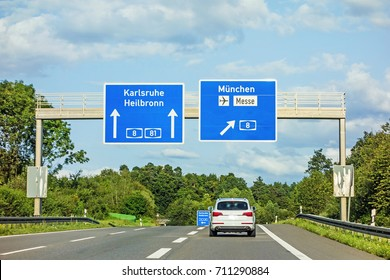 motorway road sign on (Autobahn A 81 / A 8) directions Karlsruhe / Heilbronn - exit A 8 to Munich / Airport / Messe