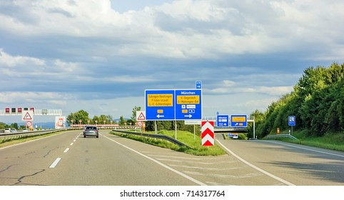 motorway road sign on (Autobahn A8 / Bundesstrasse B27) direction Tubingen Reutlingen Filderstadt Leinfelden-Echterdingen, interchange Munich, Airport / Messe, S Degerloch Mohringen