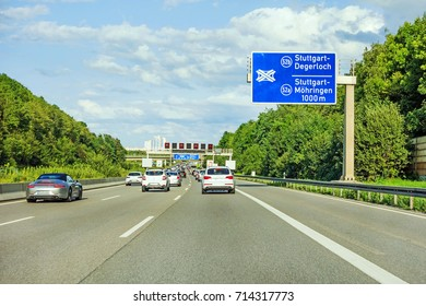 motorway road sign on (Autobahn A 8) direction to Stuttgart, exit Degerloch / Mohringen